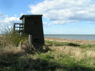 The double-decker hide, with Fenham Flats beyond (and The Snook on the horizon).