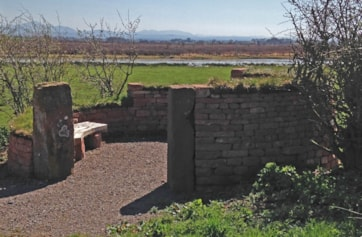 Recently installed stone circular viewing area with seat overlooking newly excavated shallow pools to encourage breeding Curlew and Snipe.