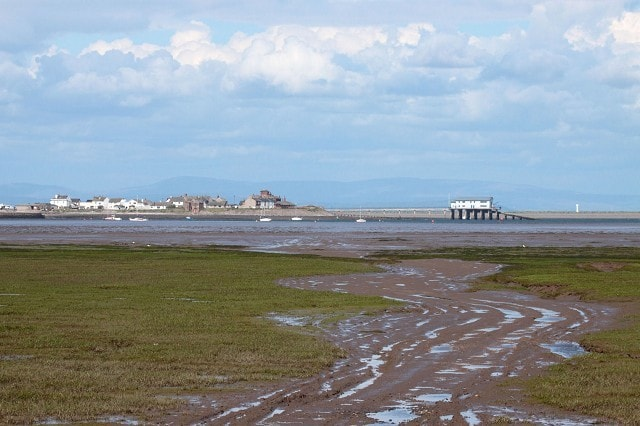 Viewed from Walney Island. Foulney Island, also, can be seen to the right behind the lifeboat station at Rampside. The white structure on the island is the Light Beacon.
