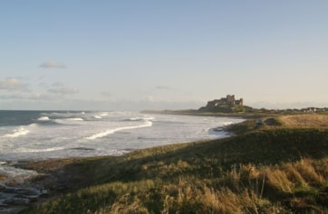 The beach and castle viewed from the road to the golf club accessed via 'The Wynding'.