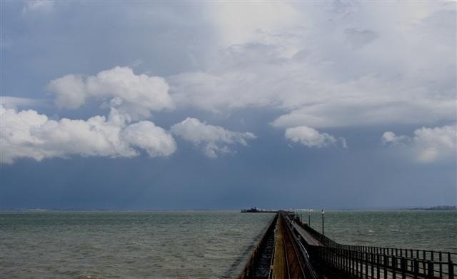 The pier with a storm brewing over Kent.