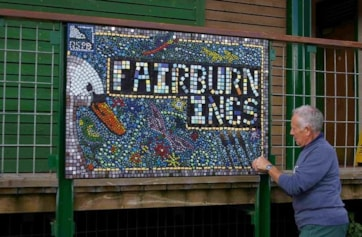 50th Anniversary celebration mosaic. Designed by Claire Walker using ideas from local school children.