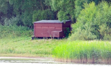 Nikon D80 with Sigma 170-500. View of the hide from the north end of the lake.