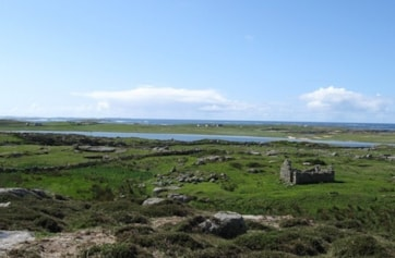 Omey Island looking over Lough Fahy. Areas of machair (short cropped natural grassland) to right. The island is accessible by car at low tide.