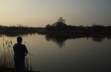Fishing until sunset from the railway embankment.