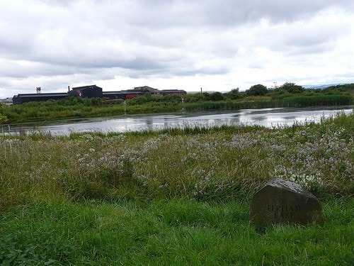 Ferham Lake at Blackburn Meadows SWT reserve, with Magna Science Centre in the background.