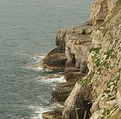 Looking westward along cliffs to Tilly Whim quarry.