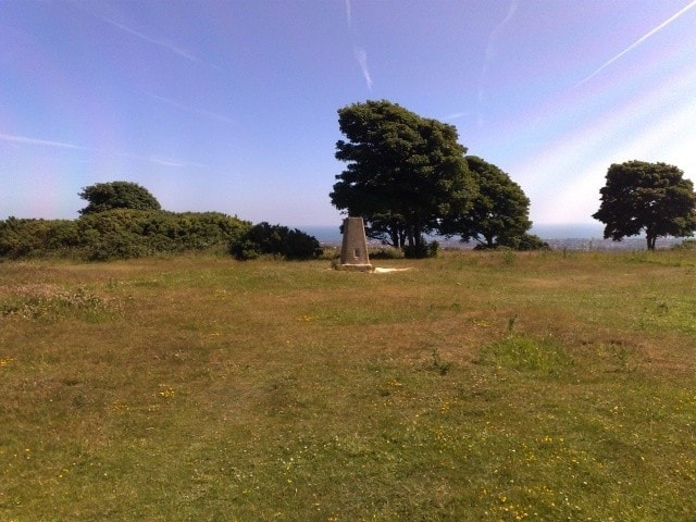 The trig point at the summit.