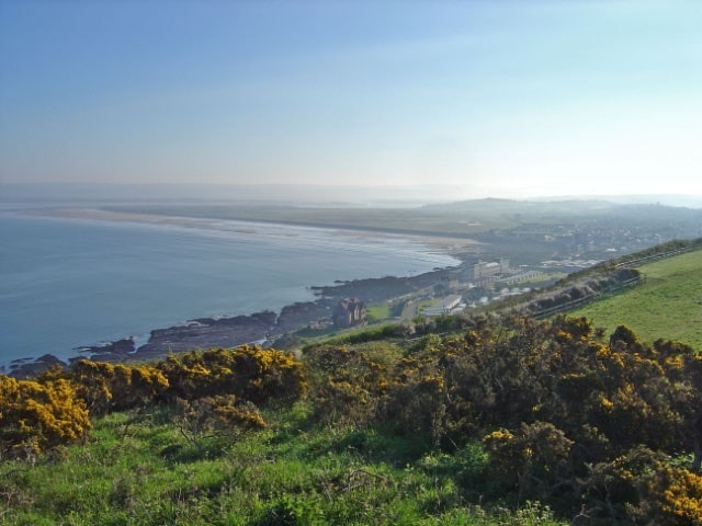 Westward Ho with Northam Burrows in the background and the Taw/Torridge Estuary beyond that.