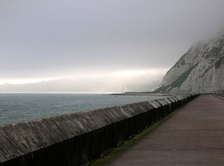 Looking west along the seawall towards Abbot's Cliff and the Warren.