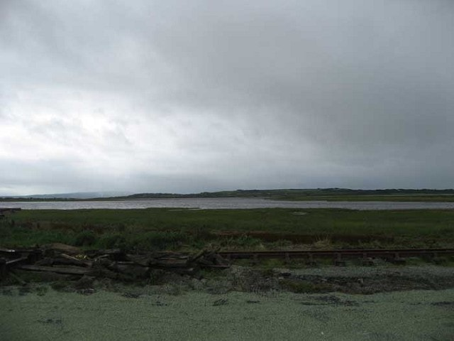 The estuary at high tide as viewed from the disused railway carriages.