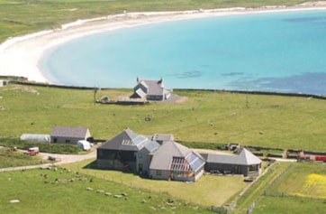 North Ronaldsay Bird Observatory and guest house. Many rare birds have been found around the observatory's grounds, and the surrounding croft land is managed to provide cover and habitat for migrants.