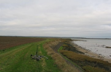 Further East along the sea wall.