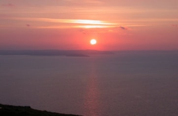 Evening view from the Great Orme looking across to Puffin Island and southeastern Anglesey.
