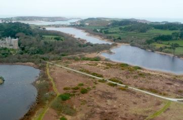 Tresco. View from helicopter, looking north. Abbey Pool in left foreground, Great Pool (two parts) to the right. Bryher in the distance, on the left.