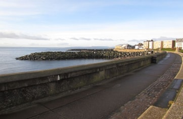 Looking north along the harbour wall.