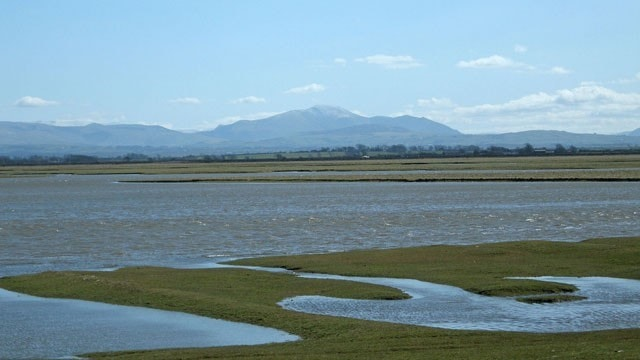 Looking across Skinburness Marsh to a distant Skiddaw from Grune Point at high tide.