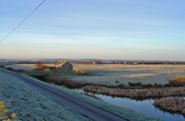 Typical view across the toll road and the marshes from the R.Caen embankment.