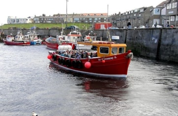 Seahouses harbour and boat to the Farne Islands.